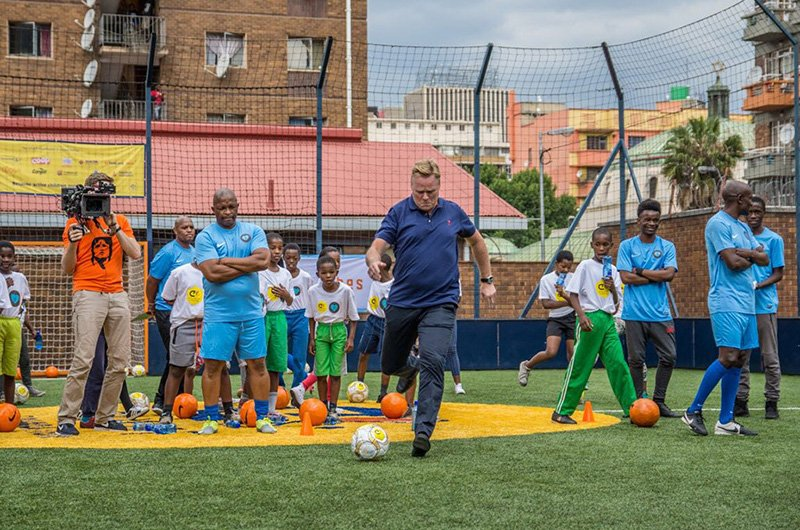 Community soccer team in action